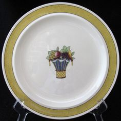 Yellow band with fruit basket center   Marked:  Directoire, Wedgwood, England   Good condition.  No chips, cracks or crazing.