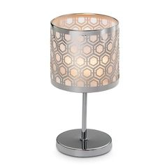 """Enchanted Silver Mini Votive Lamp  Item #:  P90999        Sleek honeycomb pattern lends a lively energy to your decor. Light a votive, or tealight sold separately, to illuminate the photo-etched metal and mesh shade. Includes a single glass votive cup. 7 3/4""""h, 4 1/4""""dia."""