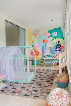 Crazy cool kids room with wall mural