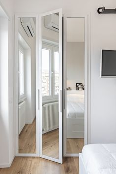 white wood and mirror closet doors for a pure white bedroom Mirrored Bifold Closet Doors, Modern Closet Doors, Closet Mirror, Bedroom Closet Doors, Mirror Closet Doors, Sliding Closet Doors, Wardrobe Doors, Bedroom Cupboard Designs, Bedroom Cupboards