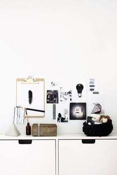 Small gallery wall with clipboard holding artwork