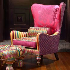 A Broadway melody of magic, wit, and candy-striped enchantment; furniture so deliriously offbeat, it is welcome anywhere. The Kaleidoscope Wing Chair features a vivid fuchsia seat back with a fabulous floral design, surrounded by zigzags, stripes, and Bittersweet Checks. Upholstered in blended poly, nylon, silk and rayon fabrics, trimmed in cotton cording, over a hardwood frame. Made in the U.S.