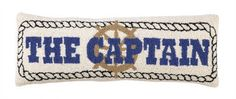 """beautifully made for your coastal cottage with rope details and """"The Captain"""" in bold navy blue lettering."""