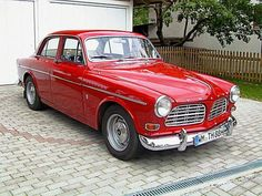 1965 Volvo 122S Sedan The fab car I owned 10 years ago albeit a lot more faded and flawed. Oh, how I loved my Ruby. : )