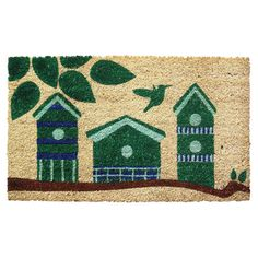 Handmade coir doormat with a stenciled birdhouse design.  Product: DoormatConstruction Material: 100% Coir