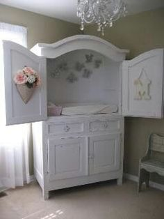 Tv armoire repurposed to diapering station with storage!