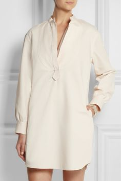 French designer Atlantique Ascoli only ever creates pieces in a blend of two fibers – she loves the freshness of cotton but wants to recreate the feeling of old linen. Cut with clean lines and oversized proportions, this dress is a contemporary approach to summer dressing. Wear yours with bare legs or layered over wide-leg pants.