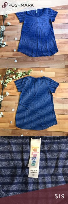 LuLaRoe Stripped Tee Size XS LuLaRoe Stripped Tee  Size XS Pre-owned Offers are welcome or add to a bundle LuLaRoe Tops Tees - Short Sleeve