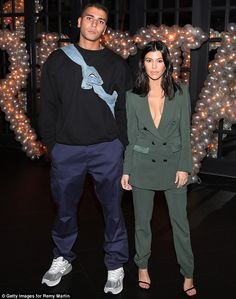 Green with envy! Kourtney Kardashian sizzled in a plunging army green suit which gave a generous glimpse of her full bust