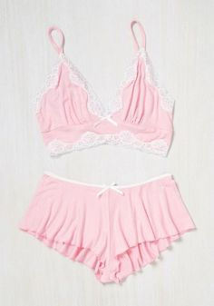 e924c317f0 Get swept up in the sweetest of slumbers with these pastel pink pajamas! A  delicate bralette trimmed in white lace and matching flutter shorts make  this ...