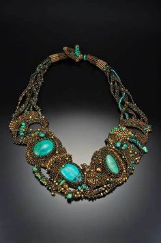 Julie Powell-Necklace  Glass seed beads, turquoise, African brass, Tiger eye