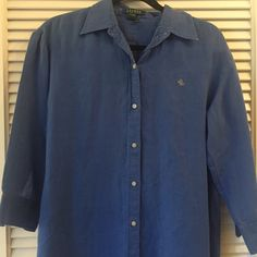 Blue Ralph Lauren button down Nice blue color, 3/4 sleeves. Has been worn but still in perfect conditions. Would look good with black pants or shorts. Ralph Lauren Tops Button Down Shirts