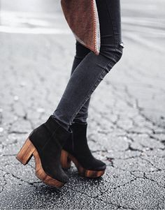 justthedesign:  We love the wooden detailing on these black heeled boots. Pair with grey skinny jeans to recreate Chloe Strickland's look.  Boots: Topshop.