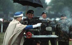 Queen Elizabeth II firing a British L85 battle rifle. Surrey, England,1993.