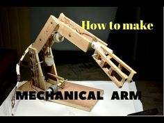 Robotic arm with wood ,nuts and geared dc motor.