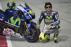 Valentino Rossi of Italy and Movistar Yamaha MotoGP poses with his bike in pit during day one of the MotoGP tests at Sepang Circuit on February 4, 2015 in Kuala Lumpur, Malaysia.