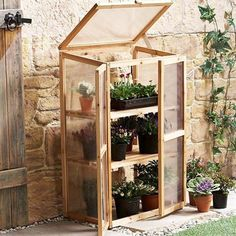 Leisure Season MG6116 Mini Greenhouse - little greenhouse cabinet for seedlings.  Cute!  Could probably be DIYed cheaply.