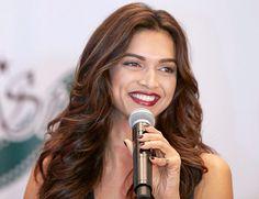 Deepika Padukone, deep red lips, brows, tousled waves