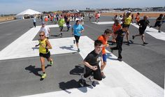 Description of . The Long Beach Airport hosted Run the Runway, a one-mile fun run on runway 25 right, that is being reopened after the runways renovations.    Long Beach Calif., Tuesday  March,31, 2015.     (Photo by Stephen Carr / Daily Breeze)
