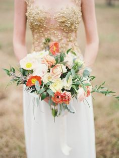 vibrant poppy bridal bouquet | Brandi Smyth Photography for @Smitten Magazine | see more on: http://burnettsboards.com/2014/04/field-dreams-editorial-smitten-magazine/ #bouquet #poppies #brides