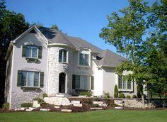 Custom home with stone turret. | http://www.homechanneltv.com/photos-home-exteriors.html