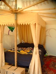 The bed canopy is mostly fabric, attached to the spokes of the tent!