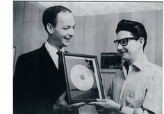 Producer of many of the iconic Orbison hits, Fred Foster presents one of their gold records to Roy Orbison