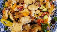 A lemon-based dressing coats grilled focaccia bread and an array of fresh vegetables and herbs in this quick panzanella salad.