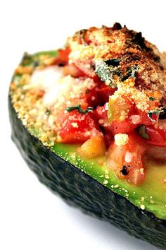 Sounds de-lish! Baked Avocado Salsa  1 ripe Avocado  ¼ cup bread crumbs*  1 garlic clove, minced  1 Tbsp. grated Parmesan cheese  1 Tbsp. basil, chopped  1 Tbsp. lemon juice  Salt and freshly ground pepper to taste  ¼ cups Roasted Garlic Tomato Salsa  Preheat oven to 450°F.