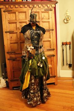 Pretty dress. I'd have to wear high boots though to make it work.