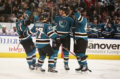 The Worcester Sharks celebrate defenseman Taylor Doherty's first goal of the season (Nov. 23, 2013).