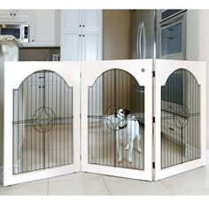 Folding wood pet gate with metal openwork detail.     Product: Pet gateConstruction Material: Wood and metalLaurel Pet Gate $152.95 $273.00