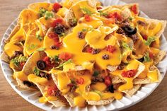 These nachos are the ultimate in cheesy, creamy, beefy deliciousness—and one of the easiest ways we know of to please a party of six in just 15 minutes.