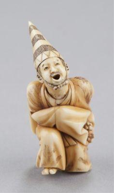 A ivory netsuke of a Sambaso dancer.