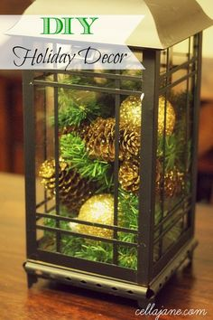 DIY Holiday centerpiece- pine cones and ornaments in a lantern