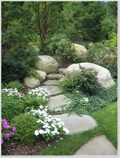 Around the rock? A little flagstone path with pretty planting's?