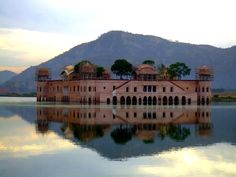 JalMahal -- Jal Mahal is a palace located in the middle of the Man Sagar Lake in Jaipur city, the capital of the state of Rajasthan, India. Tourist Places, Places To Travel, Places To See, Beautiful Buildings, Beautiful Places, Beautiful Castles, Amazing Places, Ancient Greek Architecture, Gothic Architecture