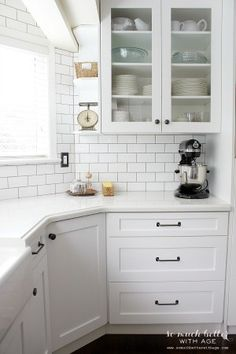 black & white kitchen / Industrial Vintage French kitchen | somuchbetterwithage.com  How to marry up side counter with counter in bump-out.