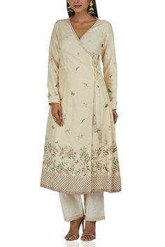 Ekaya takes inspiration from summer gardens featuring an ivory tie-up detail kurta paired with pants. Style the look with oversized chandbalis and kolhapuris. Indian Long Dress, Indian Wear, Kurti Neck Designs, Salwar Kameez, Indian Outfits, Designer Dresses, Western Style, Coat, Ethnic