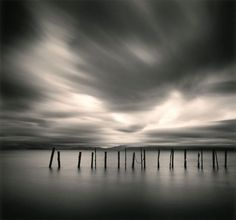 Michael Kenna | Photography and Biography. Long exposures give smudged, impossible looking skies, and smooth water.