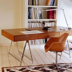 Our office in Kolonaki. #custommadefurniture by #rozivaragi #leather #vintage #officetable #tulipchair #eerosaarinen #armchair #seventiesdesign #seventies #70s #furnitureretro #furnitureredesign #rozivaragiworkshop