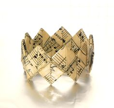 Origami bracelet made from vintage sheet music by FoldmyMusic, £8.00 - Fabulous!