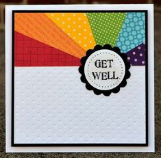 handmade get well card ... sun ray design with rays of bright colors arranged in rainbow order ... luv how it looks on the mostly white card with black mat lines ... great card!!