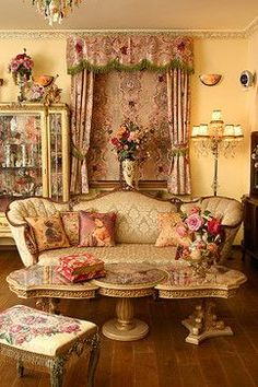 Victorian Style - eclectic style furniture which is heavy with detailed carvings and curved shapes. Colors of the victorian style - mauve, green, cream and rose are all used.  Heavy fabrics with bold patterns, crown molding