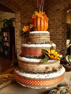 Festive October Baby Shower. Adorable pumpkin and sunflower-adorned diaper cake!