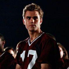 Stefan in his foot ball jersey so hot