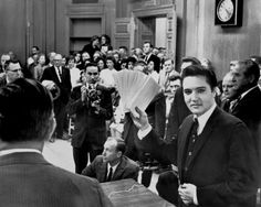 More than 150 people jammed into the mayor's office Dec. 17, 1963, to see Elvis Presley hand out Christmas checks totaling $ 55,000. The checks benefited 58 Memphis and Mid-South charities. In appreciation, the organizations presented Elvis with a six-foot plaque. It was warm in the room, and when Commissioner Claude Armour announced Elvis was going to pass out the checks, the singer wiped his brow and said, 'Elvis is going to pass out, period.'