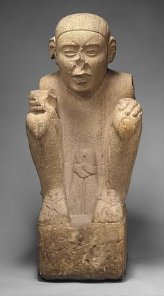 Standard Bearer, laminated sandstone (eyes lost inlays). 15th–early 16th C.  Veracruz Culture: provincial Aztec style. His sandals indicate a higher status than barefoot commoners.