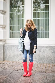 cute maternity style for fall and winter - jeans, white tee, blue jacket, and red rain boots!