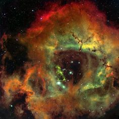 The Rosette Nebula is a large emission nebula located 3000 light-years away. The great abundance of hydrogen gas gives NGC 2237 its red color in most photographs.